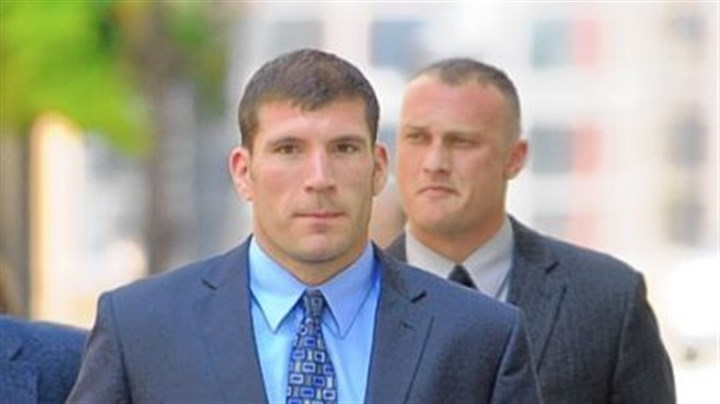 Officers arrive at Jordan Miles trial Pittsburgh police officers Michael Saldutte, left, and Richard Ewing arrive Tuesday at the U.S. District Court.
