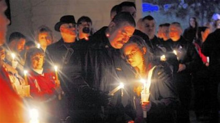 Officers, family at vigil Clairton police Sgt. James Creely and his daughter, Brittany, 15, join a vigil in Clairton for Officer James Kuzak, who was shot on duty this week.
