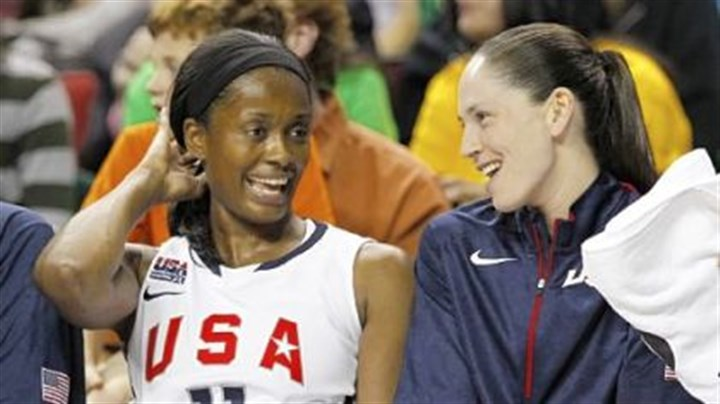 olyswin Swin Cash and Sue Bird relax on the bench in the final moments of a game against China.
