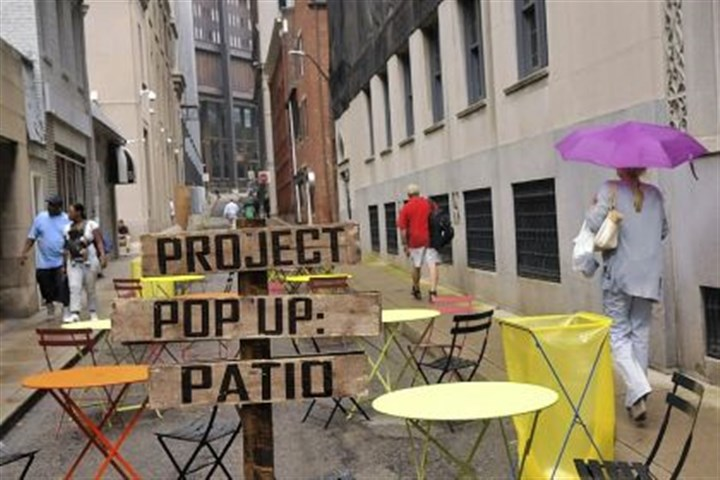 on Strawberry Way Monday's rain slowed down the use of the pop-up patio on Strawberry Way.