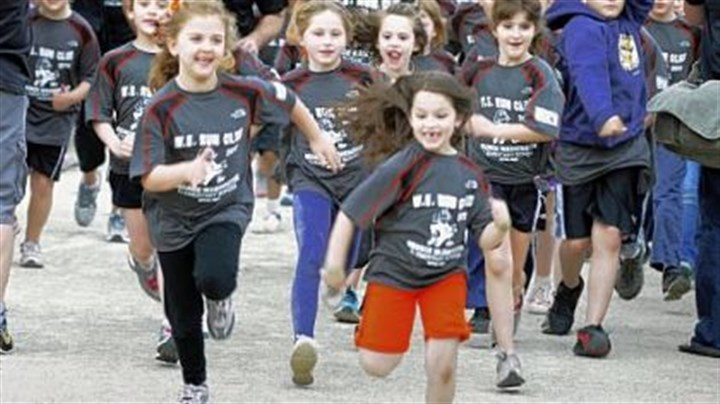 On the run George Washington Elementary School students, kindergarden to 4th graders, begin a one mile training run on the Montour Trail near their school in Bethel Park. About 200 students ran, preparing for the Kids of STEEL, joining other schools' students who will run the Kids Marathon on Saturday as part of the Pittsburgh Marathon on Sunday.