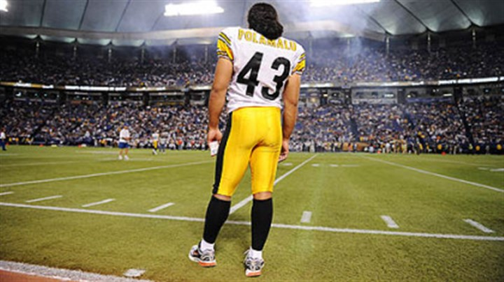 On the sidelines Steelers safety Troy Polamalu watches from the sidelines against the Vikings at the Hubert Humphrey Stadium in Minneapolis in August. He is often seen crossing himself -- right to left -- during games.