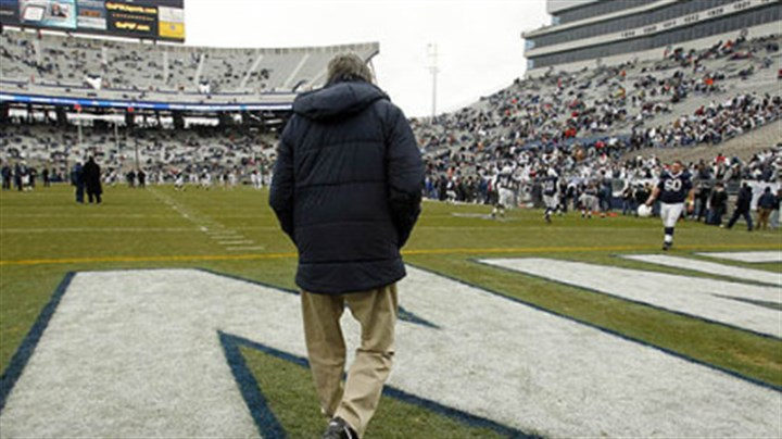 On to the field In this Nov. 27, 2010, file photo, Penn State coach Joe Paterno walks on to the field at Beaver Stadium for warm ups before a game against Michigan State.