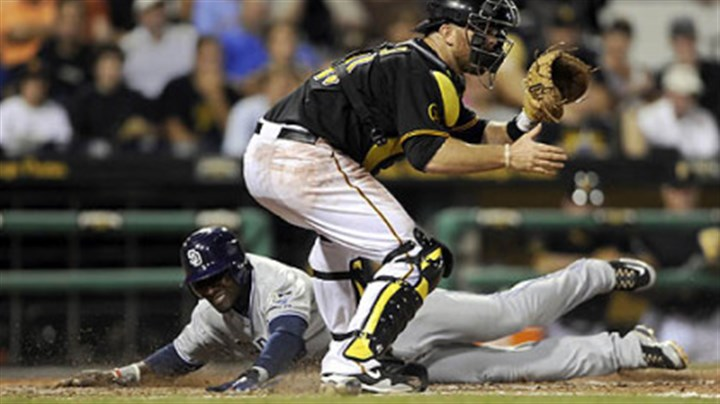Orlando Hudson and Ryan Doumit San Diego's Orlando Hudson slides past catcher Ryan Doumit with one of the 15 runs scored by the Padres Friday night in their 15-5 rout of the Pirates at PNC Park.