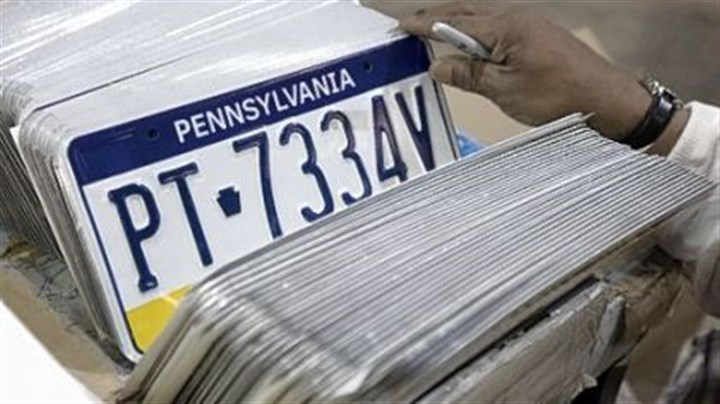 PA license plates An inmate at SCI Fayette checks license plates to make sure they were made correctly.