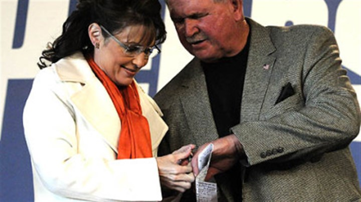 "Palin and Ditka Sarah Palin checks Mike Ditka's Super Bowl ring during a ""Road to Victory"" rally in Latrobe."