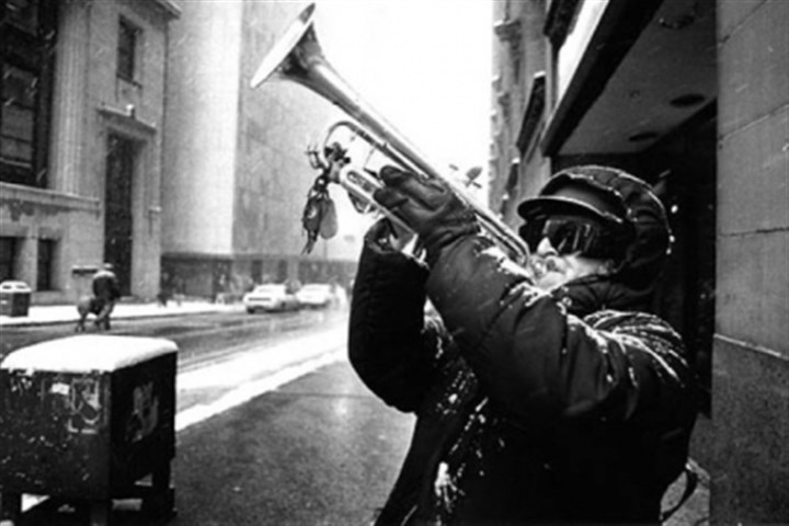 ParadeBlizzard_1 Falco Sciulli of Greenfield plays the trumpet at the corner of Fifth Avenue and Grant Street as the March 13, 1993 St. Patrick's Day Parade goes by.