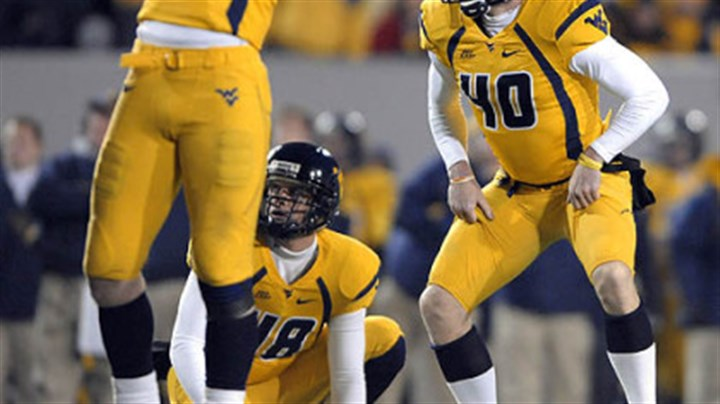 Pat McAfee and Mark Magro West Virginia kicker Pat McAfee and Mark Magro (53) react after McAfee misses his second field goal of the first half against Pitt.