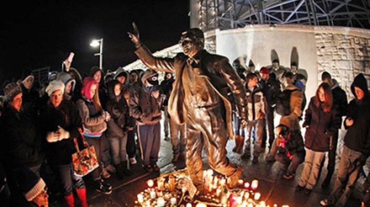 Paterno supporters People gathered Saturday night around a statue of Joe Paterno outside Beaver Stadium on the Penn State University campus.
