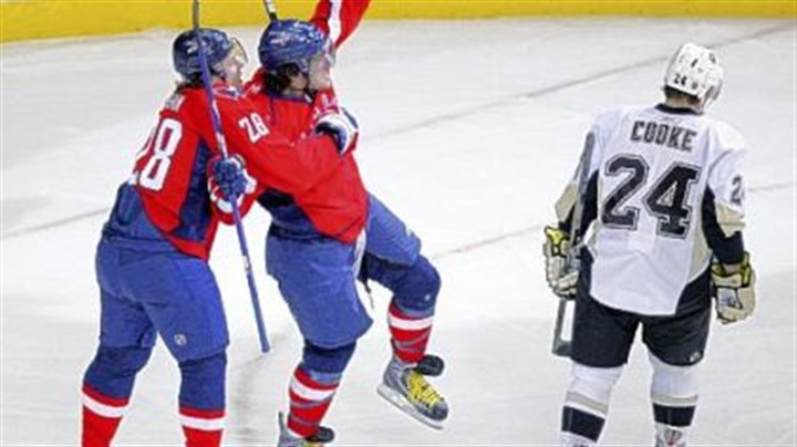 Penguins lose again Capitals left wing Alex Ovechkin, center, celebrates his goal with Alexander Semin as Matt Cooke skates by in the first period yesterday in Washington.
