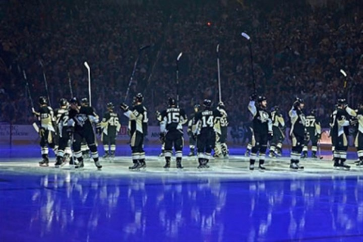 Penguins opening night Penguins wave to the crowd at opening night ceremonies at Consol Energy Center on Wednesday night.