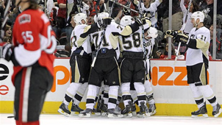 Penguins The Penguins celebrate forward Pascal Dupuis' overtime goal in Saturday's game at ScotiaBank Place in Ottawa.
