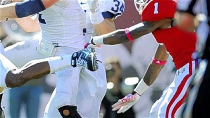 Penn State's Nathan Stupar Indiana wide receiver Shane Wynn, right, can't come down with a last-second pass to him as Penn State's Nathan Stupar, center, eyes the ball on defense Saturday in Bloomington, Ind.