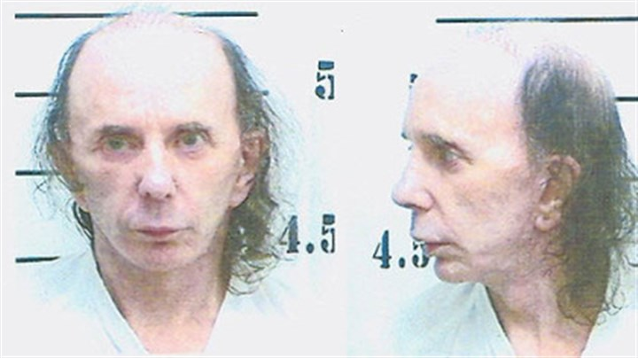 Phil Spector Known for his wild hairstyles over the years, Phil Spector appears in his June 5 prison booking photo.
