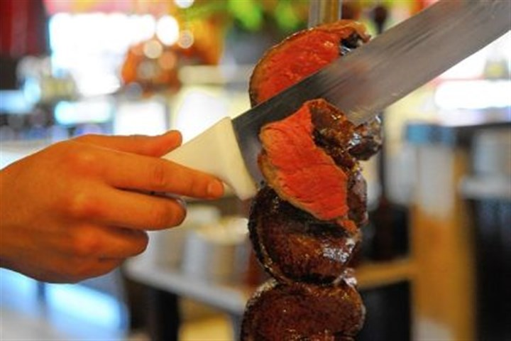 Picanha Picanha, the house specialty of top sirloin, is shaved paper thin at Texas de Brazil at Station Square, South Side,