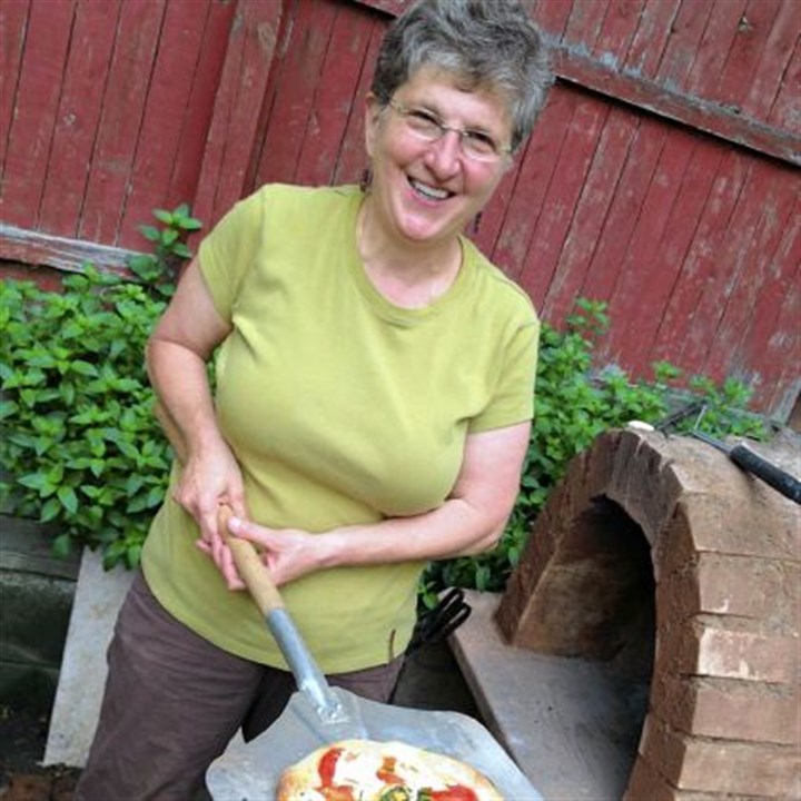 Pierina Morelli Pierina Morelli of Highland Park and her traditional clay oven.