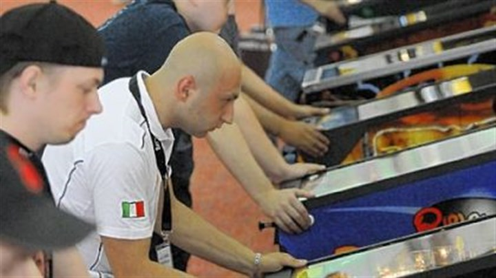 pinball championships Daniele Acciari, dressed in the white shirt, 26, of Rome, Italy, and others compete Thursday in the pinball championships in Scott.
