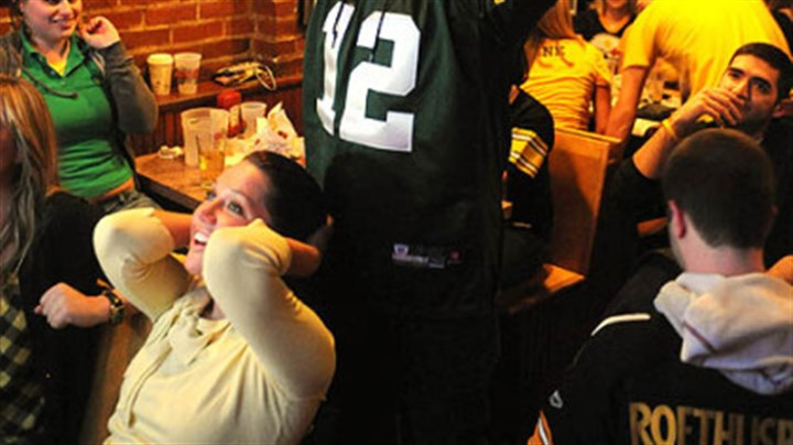 Piper's Pub, Oakland Green By fan Ed Pajewonsky of Stroughsburg, Pa., puts his hands in the air after the Steelers' final fourth down as Danielle Prima of Oakland watches in disbelief at Piper's Pub in Oakland.