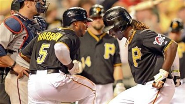 Pirates Josh Harrison greets Andrew McCutchen at home after McCutchen hit a two-run home run to put the Pirates ahead, 6-2, in the seventh inning agains the Minnesota Twins Tuesday night at PNC Park.