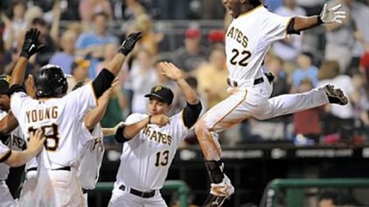 Pirates' Andrew McCutchen leaps Pirates' Andrew McCutchen leaps into his awaiting teammates after scoring the game-winning run against the Phillies at PNC Park tonight.