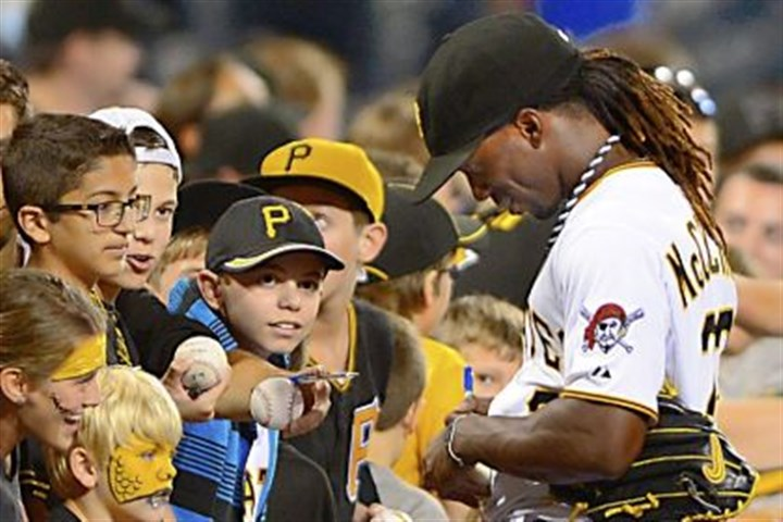 Pirates center fielder Andrew McCutchen Pirates center fielder Andrew McCutchen signs autographs before a game at PNC Park.