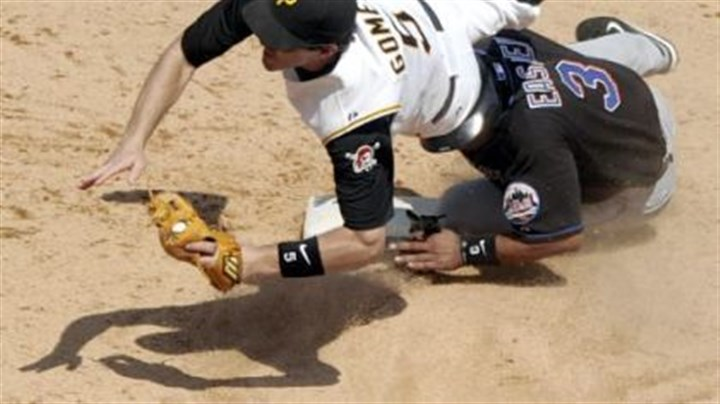 Pirates' Chris Gomez Pirates' Chris Gomez flies over Mets' Damion Easley after getting him out at second base.