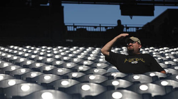 Pirates fan Shawn Gray of Canonsburg covers his eyes from the sun as he watches the Pirates beat the Dodgers, 11-1.
