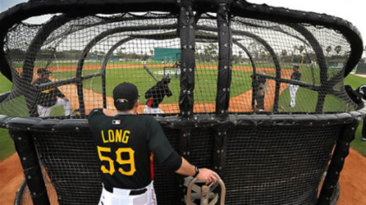 Pirates hitting coach Don Long Pirates hitting coach Don Long watches Bobby Crosby take batting practice at a morning workout at Pirate City in Bradenton, Fla. The utility infielder was mentioned by manager John Russell as a right-handed hitting possibility at first base.