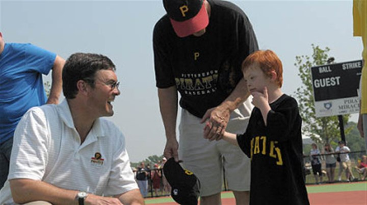 "Pirates owner and team friend Pirates owner Bob Nutting, left, talks with ""Pirates"" team member Quintin Weismantle, 6, of Eighty-Four, after opening ceremonies for the new Miracle League Field at Boyce Mayview Park in Upper St. Clair. Quintin is accompanied by his father, Wayne Weismantle."