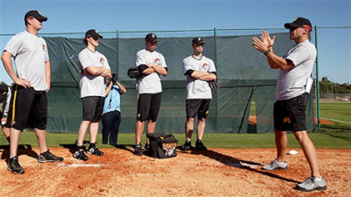 Pirates pitching staff New pitching coach Jeff Andrews, right, works with some of his pitchers yesterday on the first morning of minicamp at Pirates City in Bradenton, Fla.