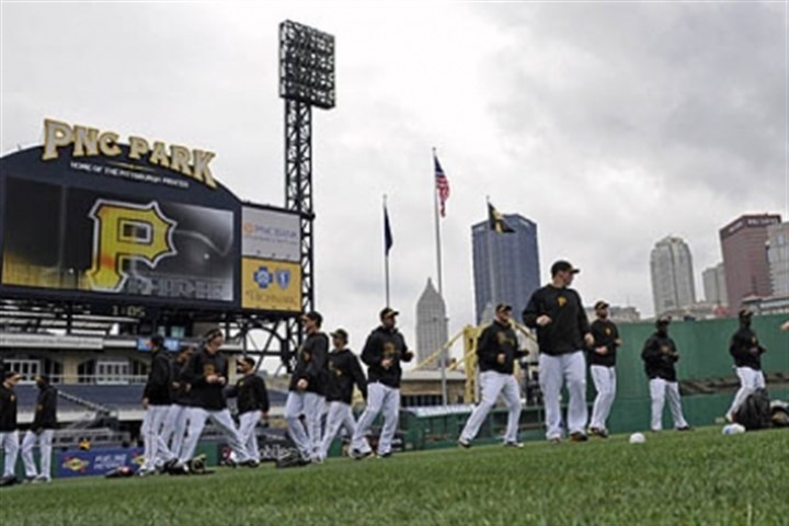 Pirates players stretch Pirates players stretch during a workout open to the public Sunday at PNC Park in preparation for today's Opening Day game against the Chicago Cubs at 1:35 p.m.