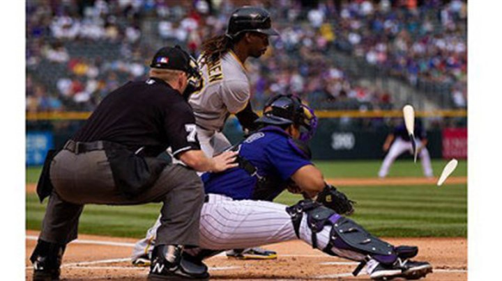 pirates vs. rockies Andrew McCutchen shatters his bat en route to grounding out in the first inning as Rockies catcher Wilin Rosario and home plate umpire Mike Muchlinski look on.