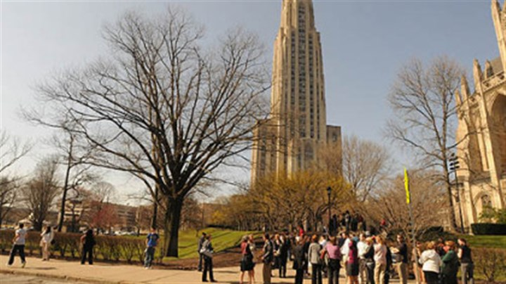 pitt campus file photo From March: People waited along South Bellefield Ave. after being evacuated from the Cathedral of Learning at the University of Pittsburgh because of the bomb threat.