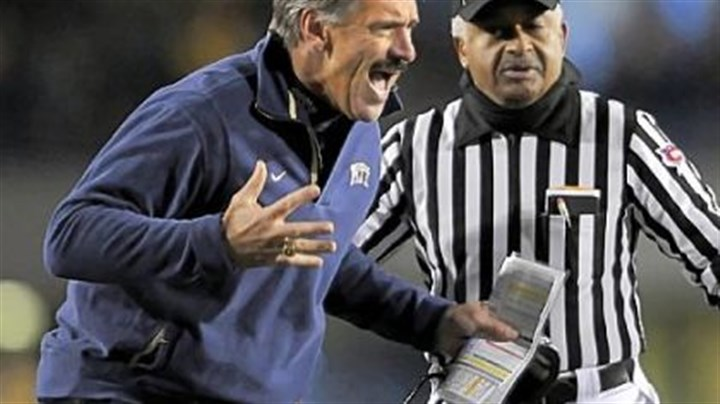 Pitt coach Dave Wannstedt Pitt coach Dave Wannstedt looks for a holding call against West Virginia in the first quarter last night at Mountaineer Field in Morgantown, W.Va.