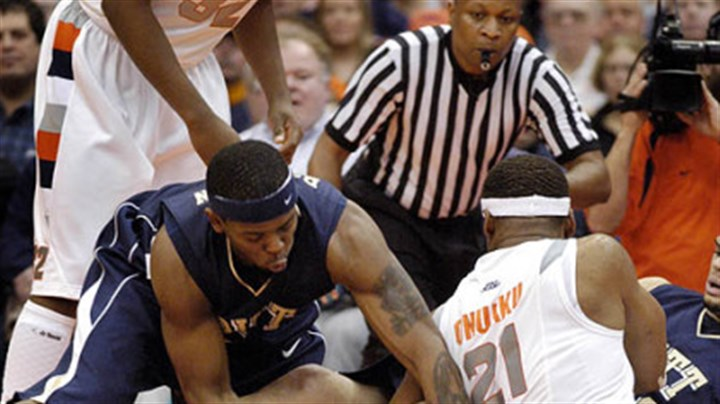 Pitt's Nasir Robinson Pitt's Nasir Robinson, left, goes down for a loose ball amid a tangle of arms and legs in the Carrier Dome yesterday in Syracuse, N.Y. The Panthers won their Big East road opener in stunning fashion against the No. 5 Orange.