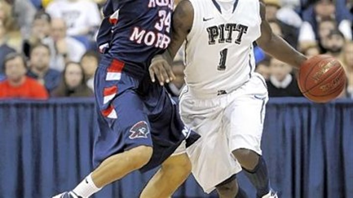 Pitt's Tray Woodall Pitt's Tray Woodall works around Robert Morris' Russell Johnson Sunday in the first half.