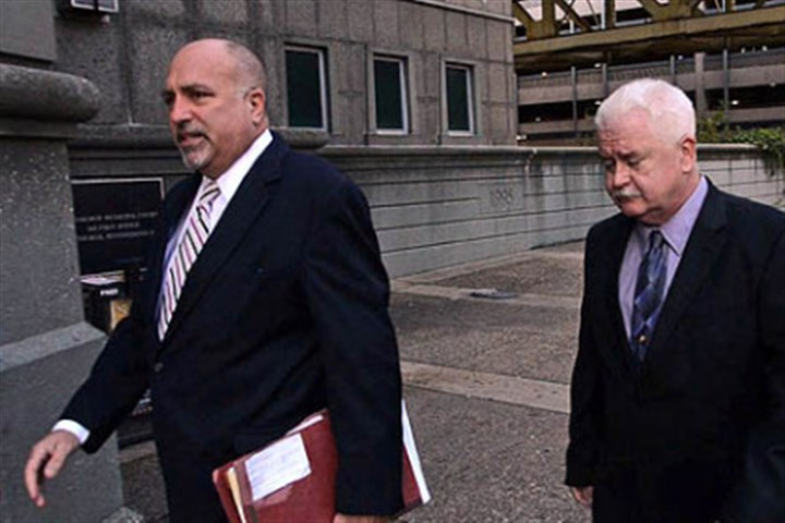 Pittsburgh police officer Kenneth Farnan Defense attorney William Difenderfer, left, walks into court this morning with Pittsburgh police officer Kenneth Farnan of Lawrenceville. Officer Farnan is charged with homicide in the Sept. 8 killing of Shawn Evans, 56, of Bloomfield, inside Condrin's Tavern.