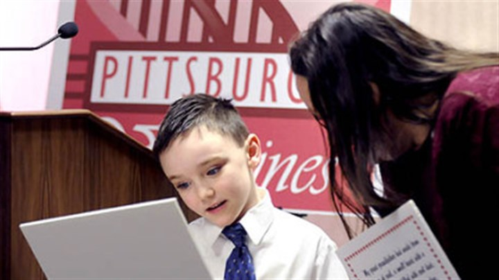 "Pittsburgh Valentine Cameron Greenaway, 7, of Baldwin shows his ""Pittsburgh Valentine"" to Toni Staab of McKees Rocks during a luncheon with Mayor Luke Ravenstahl at the City-County Building."