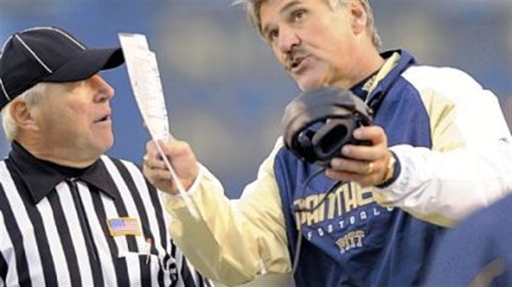 Pleading his case Dave Wannstedt pleads his case on a call with a referee in the second quarter yesterday at Heinz Field.