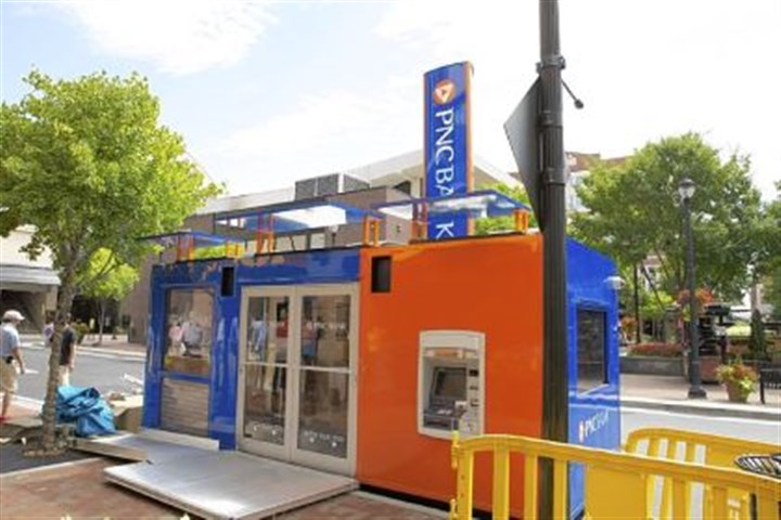 "PNC Bank 2 PNC Bank is testing its first portable ""pop-up"" branch in Atlanta. The branch is designed to be loaded onto a truck and moved to various locations."