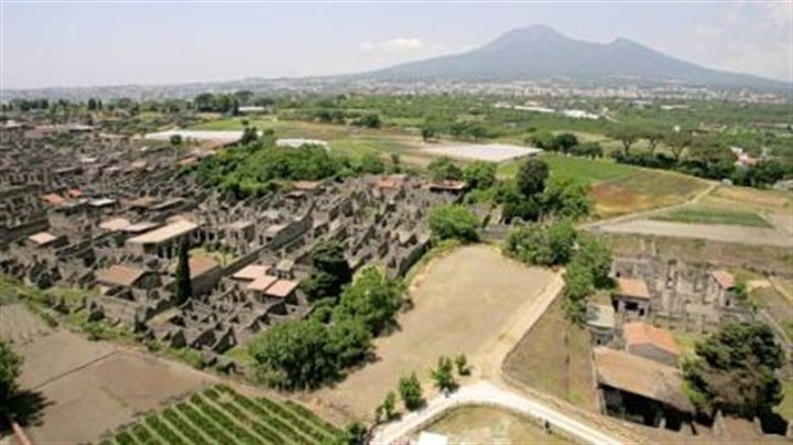 Pompeii An aerial view of the ancient Roman town of Pompeii, near Naples in southern Italy. In the background is the volcano Mount Vesuvius.