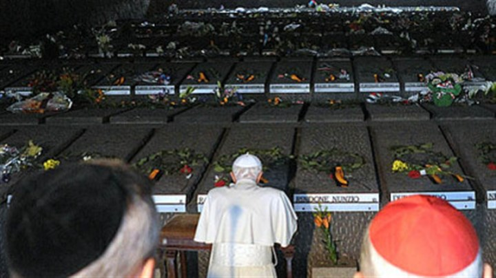 Pope Benedict XVI Pope Benedict XVI (kneeling) prays during his visit Sunday at Rome's Ardeatine Caves, where 335 Italians were slaughtered by occupying Nazis on March 24, 1944.