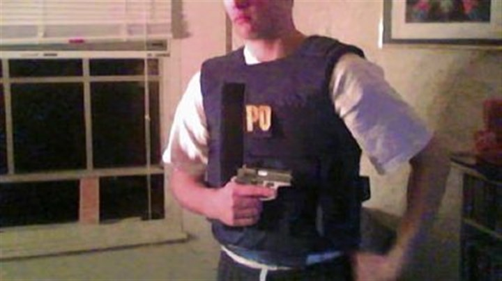 Poplawski 1 A photo found on Richard Poplawski's computer shows him posing with a semi-automatic weapon. The photo was one of three uploaded to his computer in November 2008 and presented as evidence Thursday during Mr. Poplawski's trial.