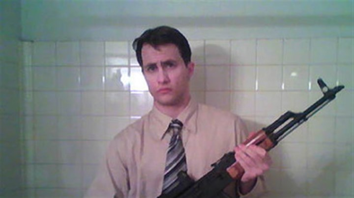 Poplawski with rifle Richard Poplawski poses with an assault rifle in this photo, which was entered as evidence. Poplawski uploaded this photo to his laptop computer in November 2008.