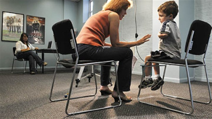 "Practice Ethan Davis, 5, of Mt. Lebanon, rehearses his lines with Donna Belajac during a casting call for the feature film ""The Next Three Days,"" which is scheduled to shoot in Pittsburgh this fall. Dozens of boys showed up at Ms. Belajac's casting agency on Market Street yesterday to audition for the roll of the 5-year-old son of Russell Crowe's character. At left is Missy Haught, an intern at the agency."