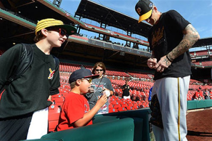 pregame burnett A.J. Burnett signs autographs during morning workouts before Game 2 of the National League Division Series at Busch Stadium in St. Louis.