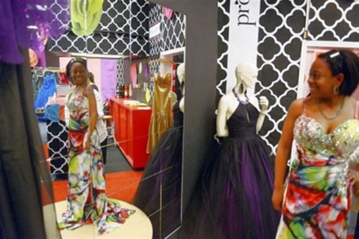 Prom Seausa Williams, 18, of McKeesport tries on prom dresses inside the Project Prom Shop at Century III Mall in West Mifflin on March 11. Project Prom, now in its 10th year, gives away dresses to girls with families that may not be able to afford a gown.
