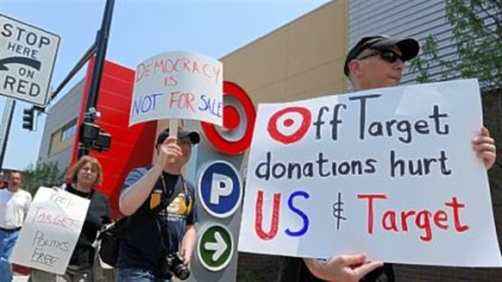 Protesters Bob King, right, 57, of Squirrel Hill and other protesters rally outside the Target store in East Liberty on Wednesday.