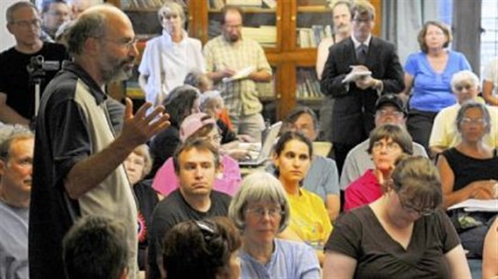 Protesters plan Jules Lobel, a University of Pittsburgh professor and vice president of the Center for Constitutional Rights, speaks at East Liberty Presbyterian Church during the meeting held by various groups looking to protest the upcoming G-20 summit.