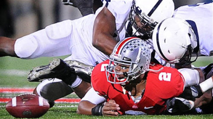 Pryor's problems Ohio State's Terrelle Pryor is tackled during a game against Penn State while in college.